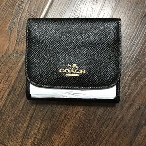 Brand new Leather Coach wallet.
